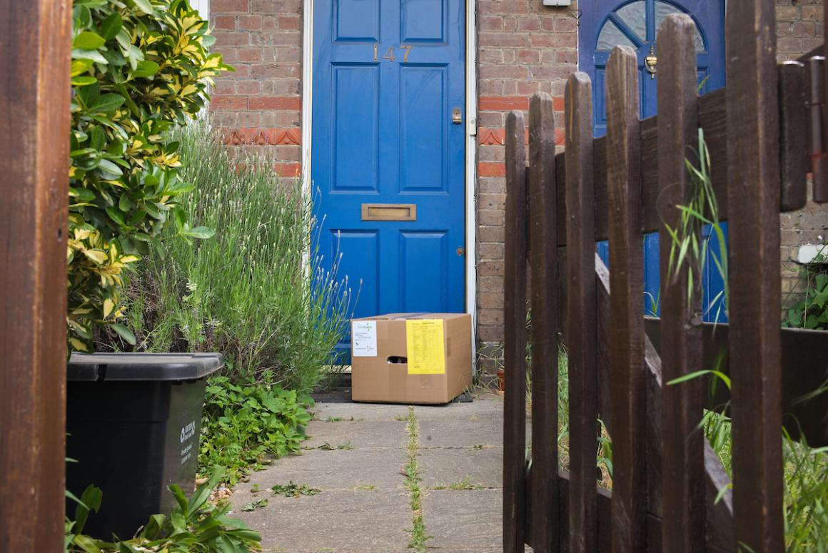 Photo of front door with food parcel
